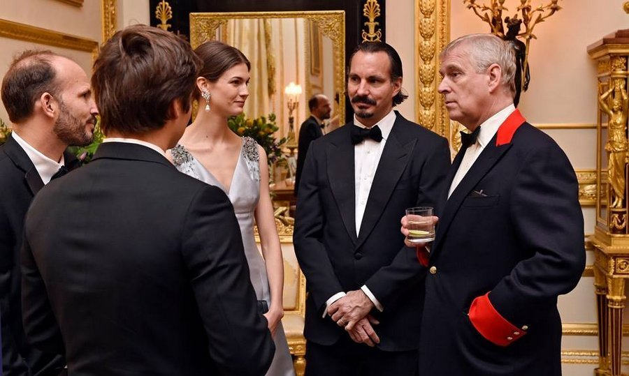 Seattle native and former runway model Kendra Spears, who became Princess Salwa in 2013 when she married the Aga Khan's son Prince Rahim, seen center, also attended. Here the couple speak with Prince Andrew.