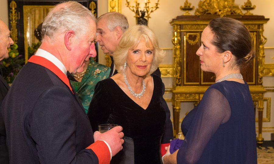 Chatting with Prince Charles, both the Duchess of Cornwall, center, and Princess Zahra Aga Khan wore gorgeous diamond necklaces for the special evening. 