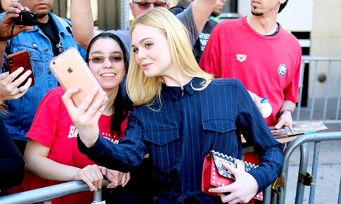 Elle Fanning stopped to snap a selfie with a fan at the premiere of her latest film, <em>Galveston</em>, at the  SXSW Festival on Mar. 10 in Austin. The film, adapted by French actress Mélanie Laurent, sees the 19-year-old as a call girl on the run with a former hit man forced to return to his hometown. 