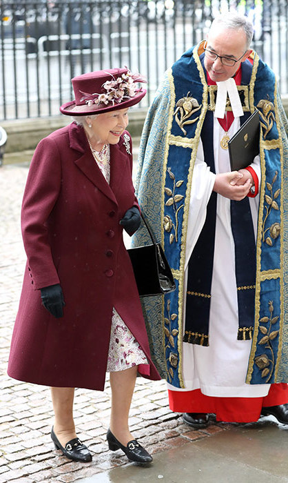 The Queen was all smiles at the Commonwealth Day service, stunning in a plum coat and matching floral hat.
