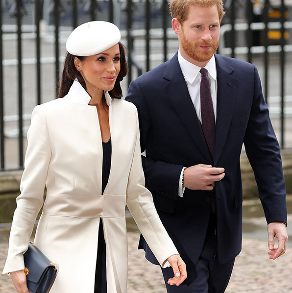 Meghan Markle and Prince Harry perfectly coordinated outfits, with the former actress donning a white coat and navy-blue dress, paired with a clutch and white beret. Harry looked dapper in a simple navy suit for the service.