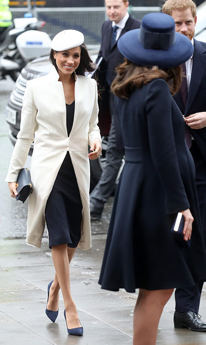 Meghan smiled at the Duchess of Cambridge as she looked back to share a moment with her future sister-in-law.