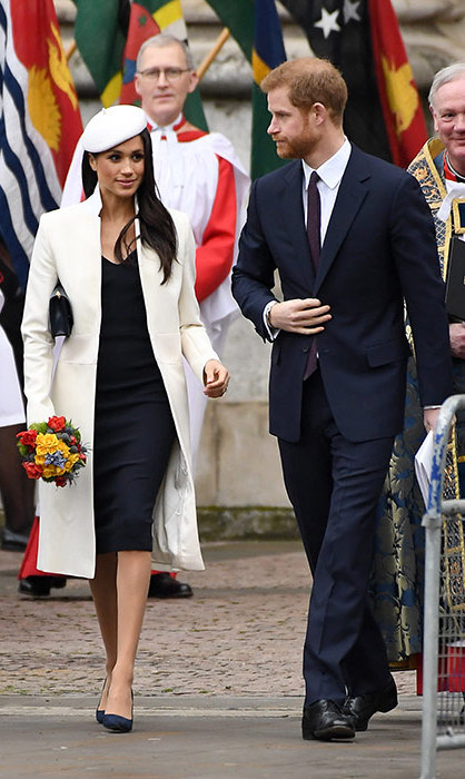 Meghan clutched on to a beautifully coloured bouquet of flowers alongside her husband-to-be Prince Harry.