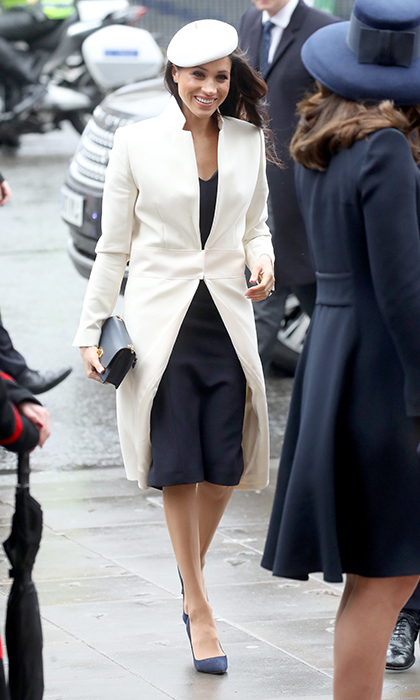 Meghan paired her beret with a white coat and navy dress by Amanda Wakeley and pumps by Manolo Blahnik.