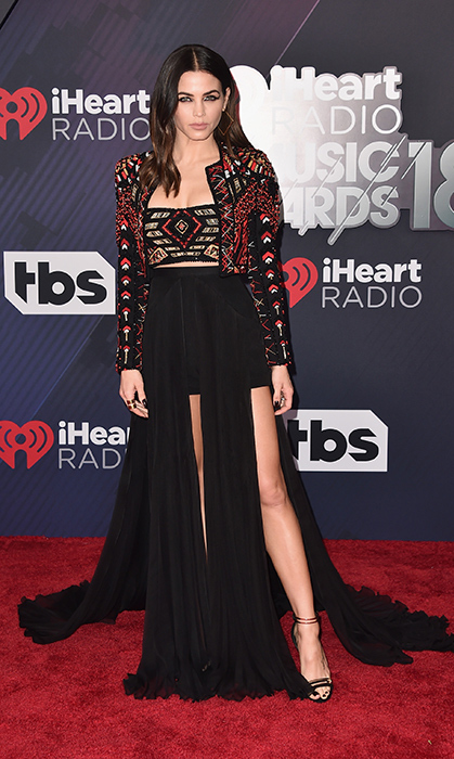 Jenna Dewan-Tatum, wife of Channing Tatum, stunned in a high-slit dress for the iHeartRadio Music awards on March 11.
