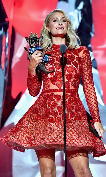 Paris Hilton wasn't alone on the iHeartRadio stage March 11! She was joined by her adorable Chihuahua puppy Diamond, who donned a mini tiara for the occasion.