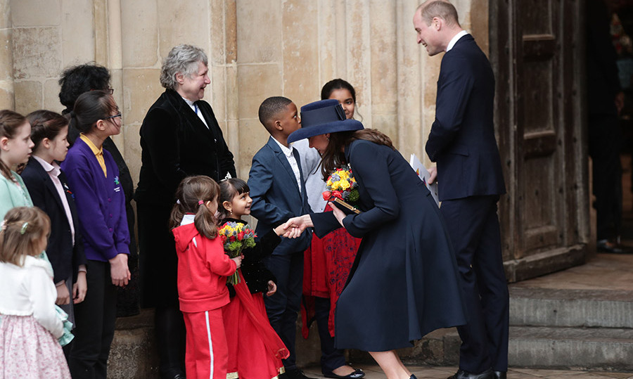 Duchess Kate took a turn to greet the children while exiting Westminster Abbey.