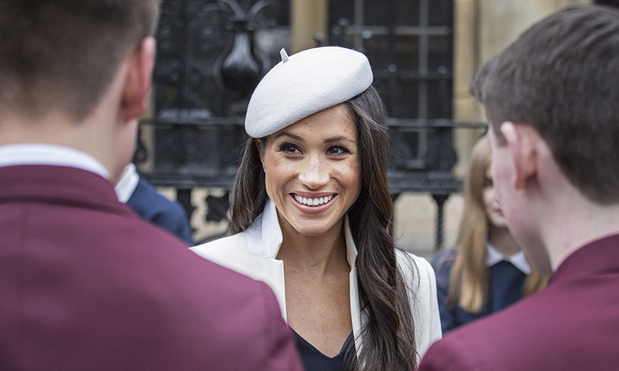 Meghan graciously spent some time chatting with a group of schoolboys outside of Westminster Abbey.