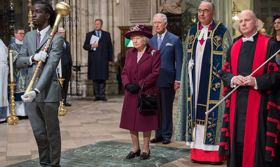 The Queen waited to take her seat, standing during a procession.