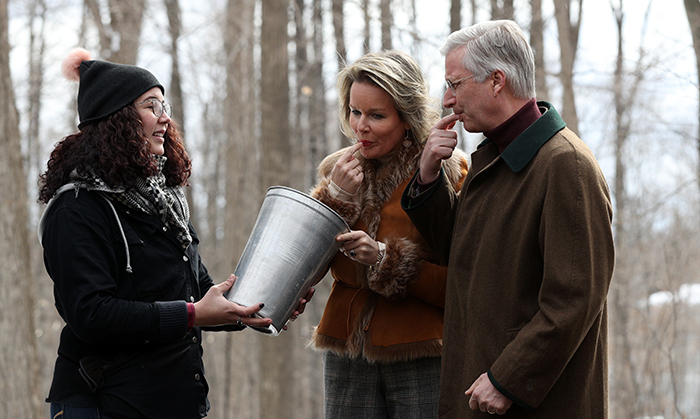 Care for a taste? Emilie Brenning, the program director for the Richelieu Park Sugar Shack, let the royal duo dip their fingers into a batch of freshly-tapped syrup, straight from the tree.
