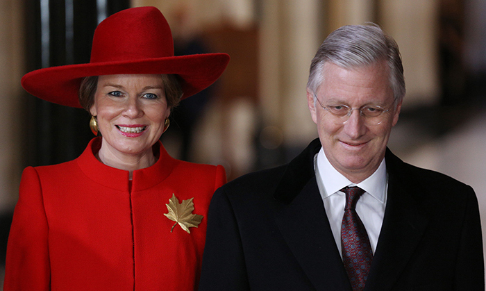 The King and Queen were all smiles while visiting Ottawa's Parliament Hill on Mar. 12. Her Majesty looked very Canadian in a bright red coat and matching hat, sporting a large golden maple leaf brooch.