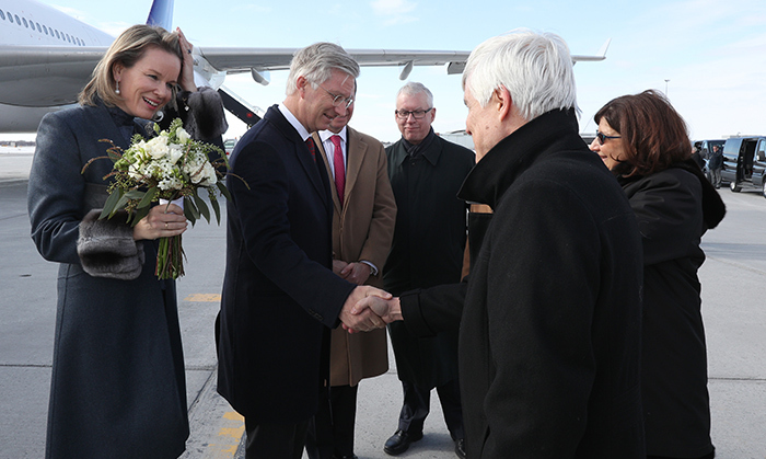 They've arrived! Iranian politician Fatemeh Javadi offered Queen Mathilde a stunning bouquet of flowers after the Belgian royals touched down at Ottawa's international airport.