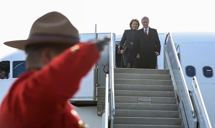 A Royal Canadian Mounted Police officer saluted the King and Queen of Belgium as they descended their plane on Mar. 11 in Ottawa - a quintessentially Canadian welcome! Queen Mathilde wore a stunning slate grey coat, complete with fur cuffs and pearl drop earrings.