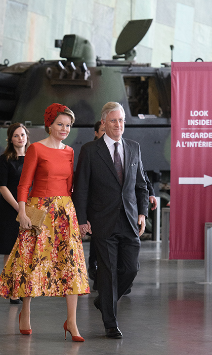 Her Majesty looked totally ready for spring in a gorgeous floral skirt and red boat-neck top. Pulling the ensemble together with red heels and a hat, she walked hand-in-hand with King Philippe at the Canadian War Museum.