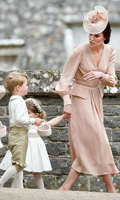 Prince George and Princess Charlotte were among the cutest members of auntie Pippa's bridal party, but the little pageboy stepped out of line and had to be reprimanded by mom Kate as she held on to his sister's hand. While he was spotted spilling out his petals and getting silly behind the bride's wedding dress, we're not sure what caused this brief, tear-filled exchange. But as they do, George was back at it having fun again in no time!