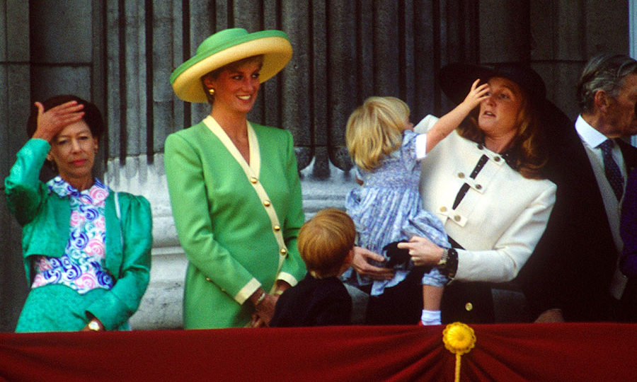 Princess Beatrice was a handful for mom Sarah, the Duchess of York, during a Buckingham Palace balcony appearance. The energetic youngster tried to grab mom's hat as the Duchess of York leaned back comically to the delight of Prince William and Princess Diana.