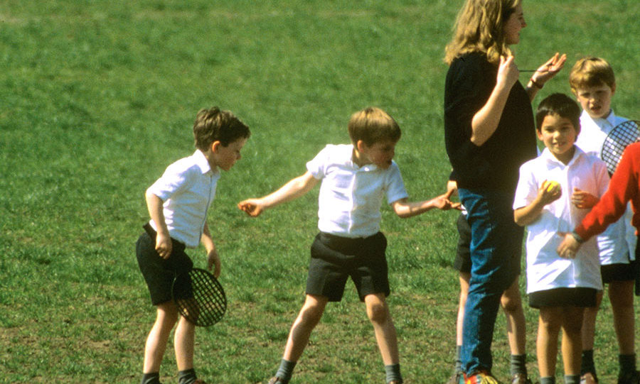 Prince William got cheeky with his teacher, literally. The little rascal gave his teacher a quick pinch during a tennis lesson in the park while one of his friends looked on in amazement.
