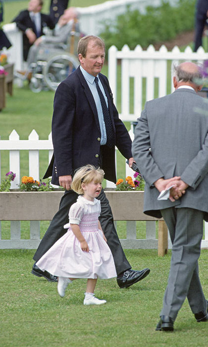 Princess Beatrice wasn't having any of it at a polo fundraiser in in 1991, where the little royal - clad in a pretty pink and white party dress - threw quite the tantrum. Though we're not sure what all the fuss was about, her bodyguard seemed amused walking alongside the princess.
