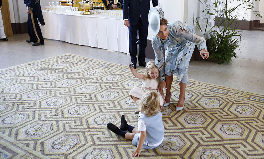 Princess Madeleine seemed to be fighting a losing battle with her giggly little girl, Princess Leonore of Sweden, who was perched on a rug with a little friend. As her mom tried to distract her by pointing to something in the distance, the royal cutie looked to be holding her ground.