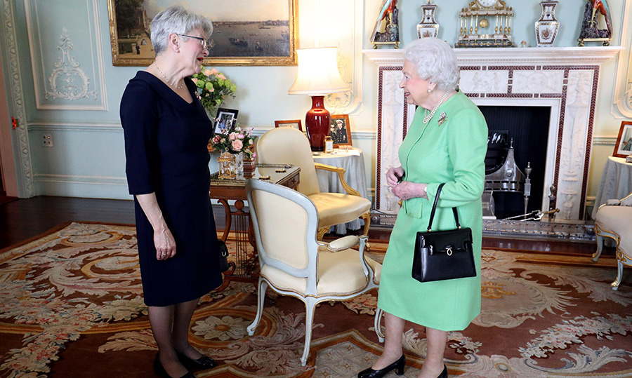 The Queen stuns in lime green! Her Majesty greeted the Lieutenant Governor of Prince Edward Island Antoinette Perry during a private audience at Buckingham Palace on March 15.