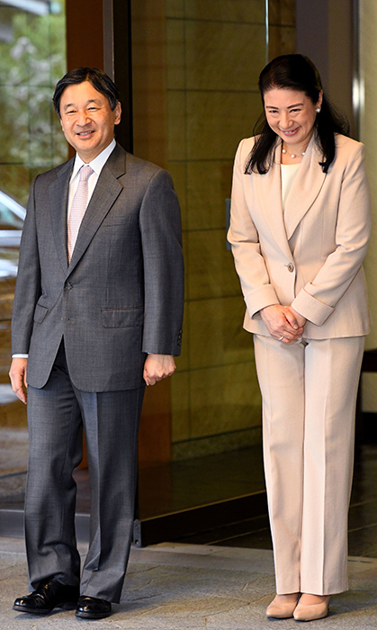 Crown Prince Naruhito and Crown Princess Masako of Japan paused for photos at the entrance of Togu Palace as the prince prepared to leave for Brazil on March 16.