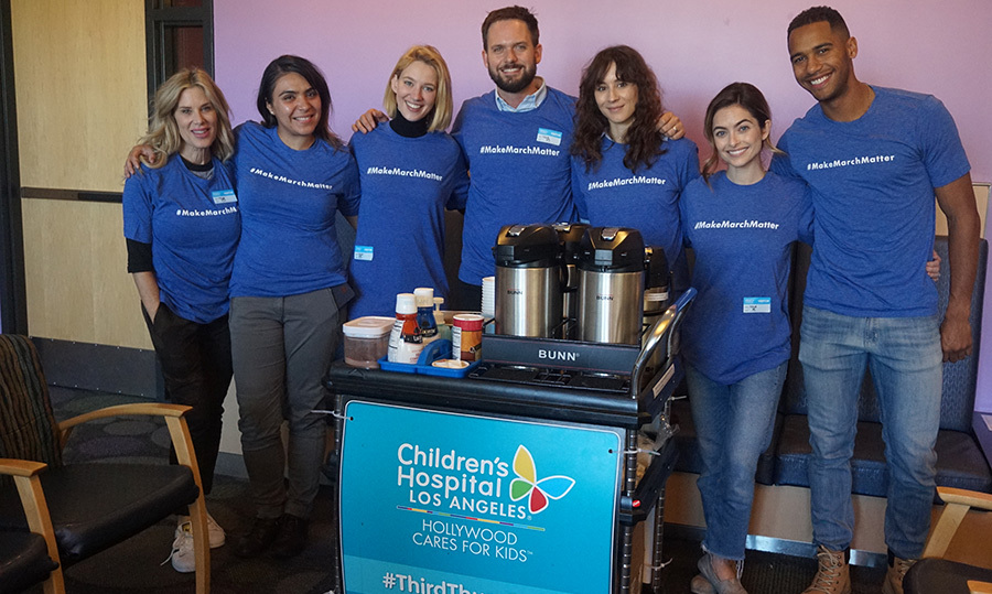 Patrick J. Adams and his wife Troian Bellisario took some time out of their busy schedules to volunteer with Make March Matter, a campaign that benefits the Children's Hospital Los Angeles.
