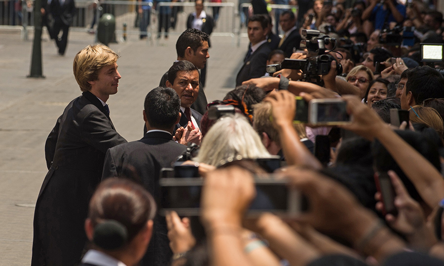 <p>The groom Prince Christian graciously greeted his fans outside of Basilica San Pedro.</p>