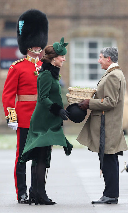 Choosing to dress patriotically, the pregnant royal opted to wear her trusted green coat with fur collar and cuffs, which she also wore during her and William's recent royal visit to Sweden.