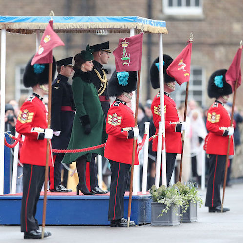 The Duke and Duchess of Cambridge braved freezing conditions to celebrate St Patrick's Day on Saturday by attending a parade of the Irish Guards. Prince William, who is Colonel of the Irish Guards, and Kate visited the 1st Battalion at their base in Hounslow, west London. The couple, who are expecting their third child, watched the 350 soldiers arrive at the Parade Square, where Duchess Kate then presented a shamrock to officers and warrant officers. 