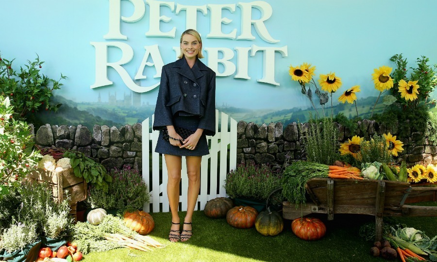 Margot Robbie opted for a Chanel ensemble as she walked the green grass carpet on St. Patrick's Day. The 27-year-old Oscar nominee went back to her native land of Australia to premiere her new movie Peter Rabbit.