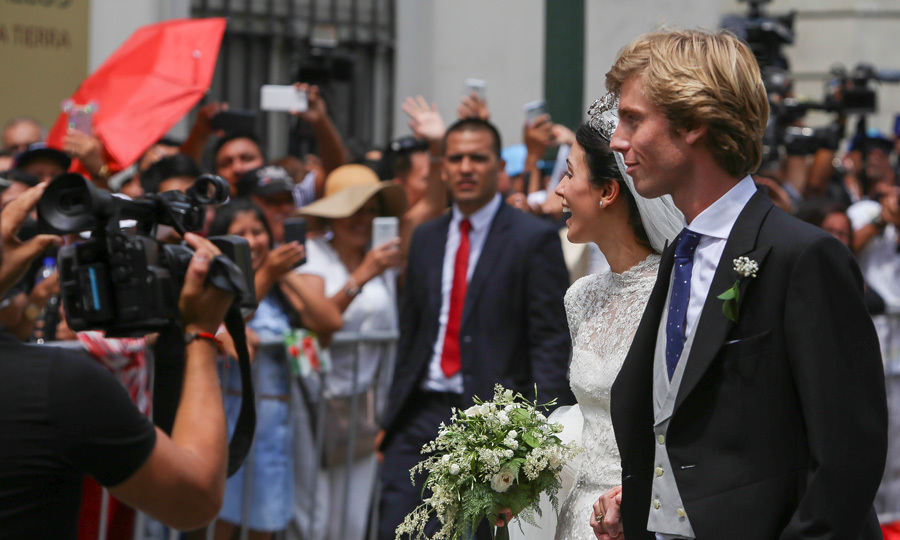 <p>The bride and groom glanced at the faces in the crowd, who showed up to witness the happy couple's wedding day.</p>