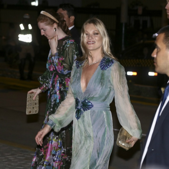 <p>Kate Moss dressed in a teal and earthy flowing dress for the wedding's evening event at the Pedro de Osma Museum.</p>