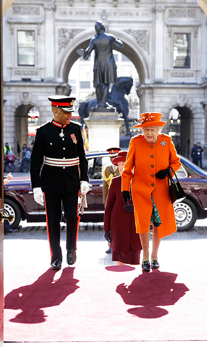 Queen Elizabeth II looked lovely in an orange ensemble while visiting the Royal Academy of Arts in London.