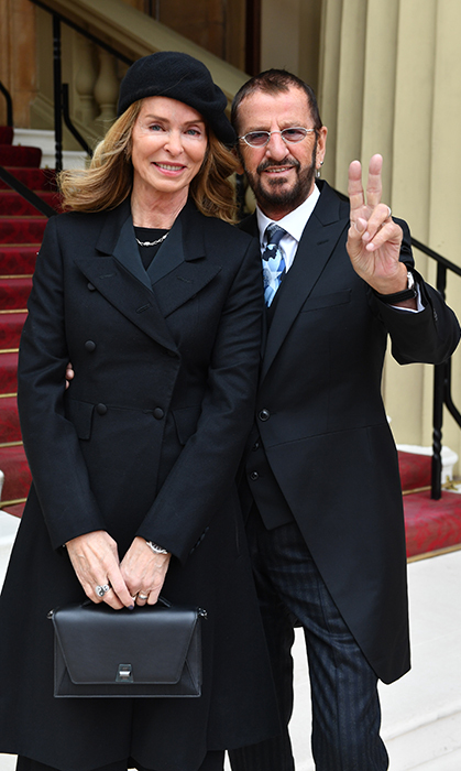 Peace! Former Beatle Ringo Starr and his wife Barbara Bach posed for a photo outside of Buckingham Palace on March 20.