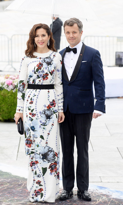 <p>Rain showers made <a href=/tags/0/crown-princess-mary><strong>Crown Princess Mary</strong></a>'s white floral gown pop as she stood next to husband <a href=/tags/0/prince-frederik><strong>Prince Frederik</strong></a> during <a href=/tags/0/king-harald><strong>King Harald</strong></a> and <a href=/tags/0/queen-sonja><strong>Queen Sonja</strong></a> of Norway's joint 80th birthday celebrations.