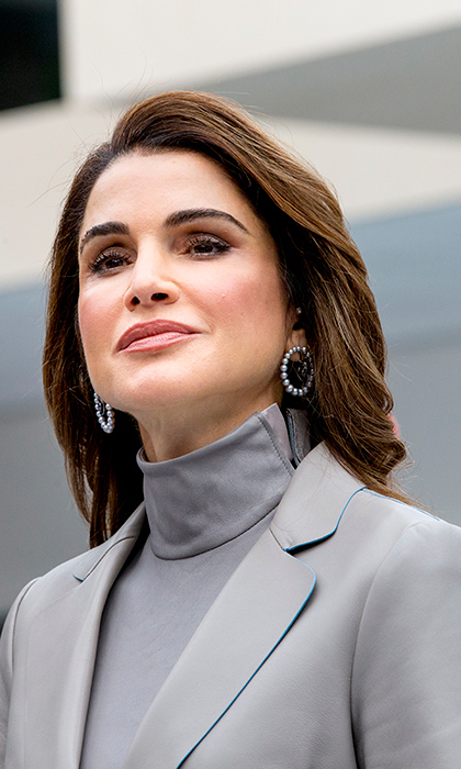 <p>Queen Rania is a fashion dynamo! The Jordanian royal looked effortlessly chic topping off her look with a pair of pearl hoop earrings while visiting the ROC Mondriaan technical school on March 21 with Queen Maxima.</p>