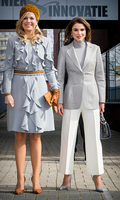 <p>We didn't get the memo! It looks like dove grey was the colour du jour for these two fierce royals as they took The Hague by storm on March 21. Queen Maxima paired her delicately ruffled dress with camel accessories and a turban while Queen Rania rocked a grey turtleneck and blazer with white, ankle-length pants.</p>
