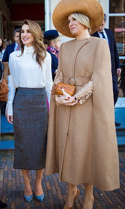 <p>Queen Rania shed her blue coat to show off her signature business-chic attire, anchored by a pretty pair of blue pumps.</p>