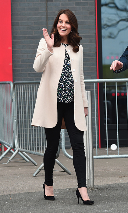 The Duchess of Cambridge traded her usual dress for a chic pair of black trousers, a Hobbs top and an $1100 cream coat by Goat as she wowed the crowds at Olympic park on her second public appearance of the week.