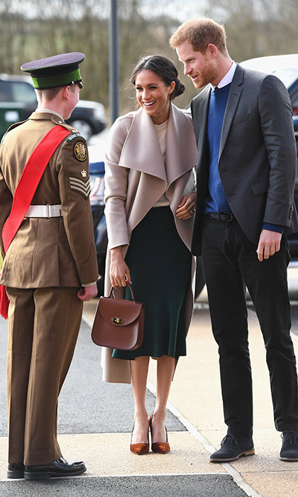 <p>Harry and Meghan began their day at the former Maze paramilitary prison outside Lisburn where around 2,500 young people from both sides of the Irish border had gathered for a peace-building event. They were greeted by Londonderry students Amber Hamilton, from Foyle College, and Ryan McCallion, from St Joseph's Boys school, both 17, before meeting a number of dignitaries including Police Service of Northern Ireland Chief Constable George Hamilton.</p>