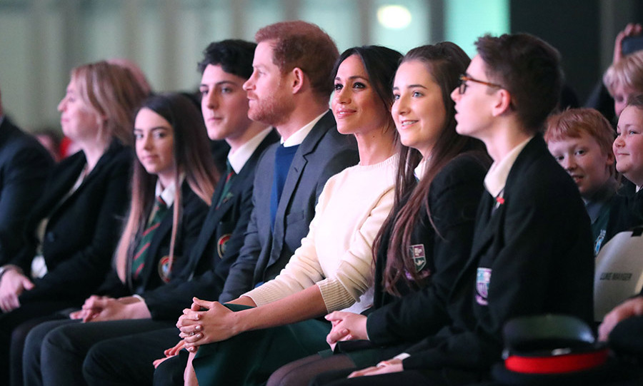 <p>Meghan appeared to be enjoying herself as she sat next to school children at the exhibition centre in Lisburn.</p>