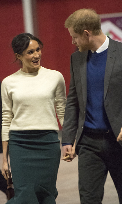 Affectionate Meghan and Harry walked hand in hand at the Eikon Centre. 