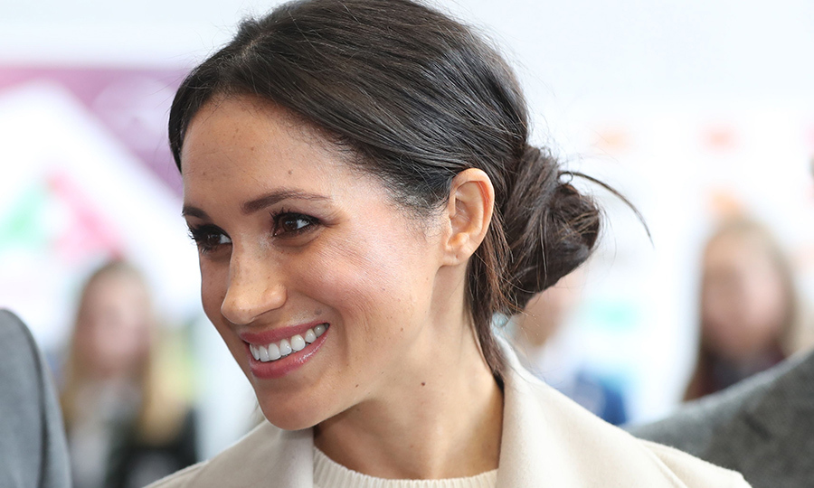 <p>Meghan sported the chicest of side buns for her royal outing with Prince Harry in the quaint city of Belfast. Keeping her hairstyle the perfect combination of prim and slightly messy, the royal-to-be showed off her simple smoky makeup look.</p>