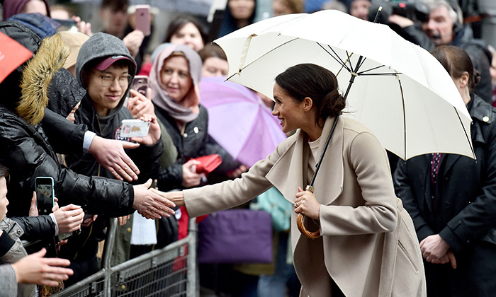 A little rain couldn't stop Meghan from greeting fans after visiting Crown Bar. At one point she ran over to the gates to shake hands with a sweet little girl!