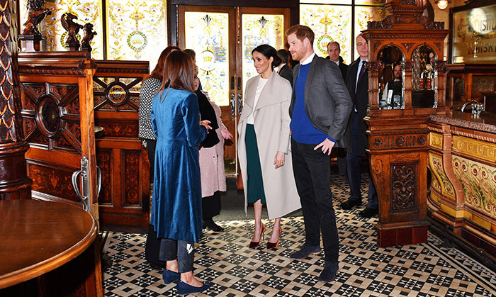 What better way to introduce Meghan to the UK than a visit to a pub? Inside the historic spot, the future bride and groom heard all about the Crown's storied history.