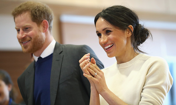 Meghan may have skipped wearing earrings on this particular outing but she didn't leave her most prized piece of jewelry - her stunning diamond engagement ring - at home!