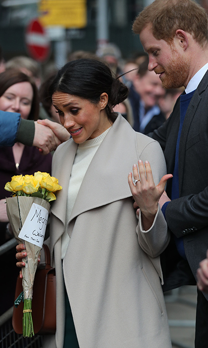 Meghan received a pretty bouquet of yellow flowers from a young fan along with a note that said 'Meghan and Harry, Welcome to Belfast.' She was visibly touched!