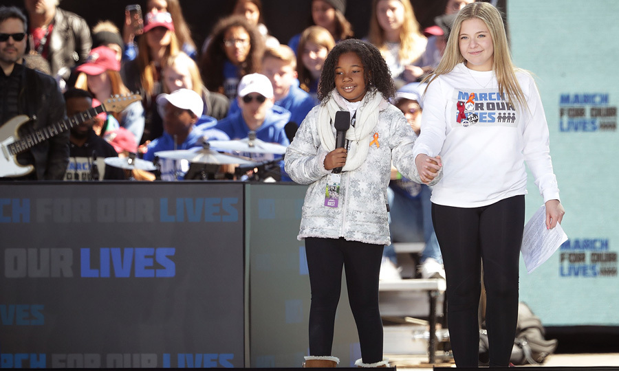 "Martin Luther King, Jr.'s granddaughter Yolanda Renee King joined Marjory Stoneman Douglas High School Student Jaclyn Corin on stage at the March for Our Lives rally, where they chanted ""It stops now.""