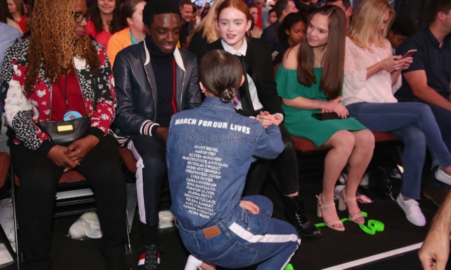 "Millie, who took home the award for ""Favorite TV Actress,"" dressed with purpose. The starlet's customized denim button down said it all. Embroidered on the back were the names of the 17 victims of the Parkland, Florida shooting. Above the names, it read ""March For Our Lives,"" clearly supporting the weekend's nationwide protest against gun violence.
