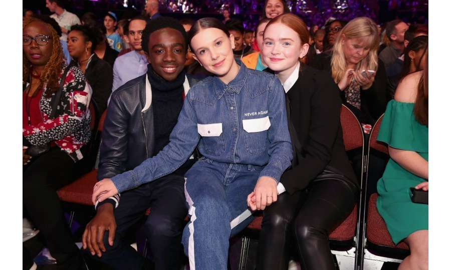 Caleb McLaughlin, Millie Bobby Brown and Sadie Sink had a blast front row at Nickelodeon's 2018 Kids' Choice Awards. The <em>Stranger Things</em> trio presented onstage together at the fun show, which took place at the Forum on March 24 in Inglewood, California. 